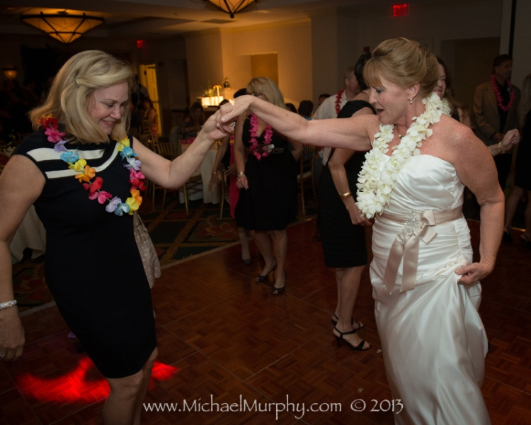 Bride dances with a guest at her reception in the Riverside Hotel, Ft. Lauderdale.