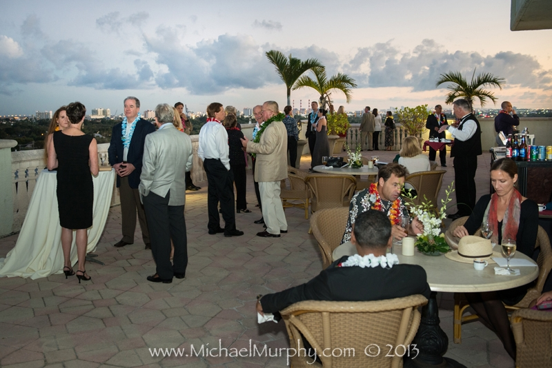 The sun sets while wedding guests enjoy cocktails on the patio of the Riverside Hotel in Ft. Lauderdale.