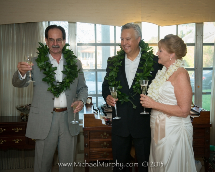 The Best Man toasts the bride and groom at an intimate at home wedding ceremony in Ft. Lauderdale.