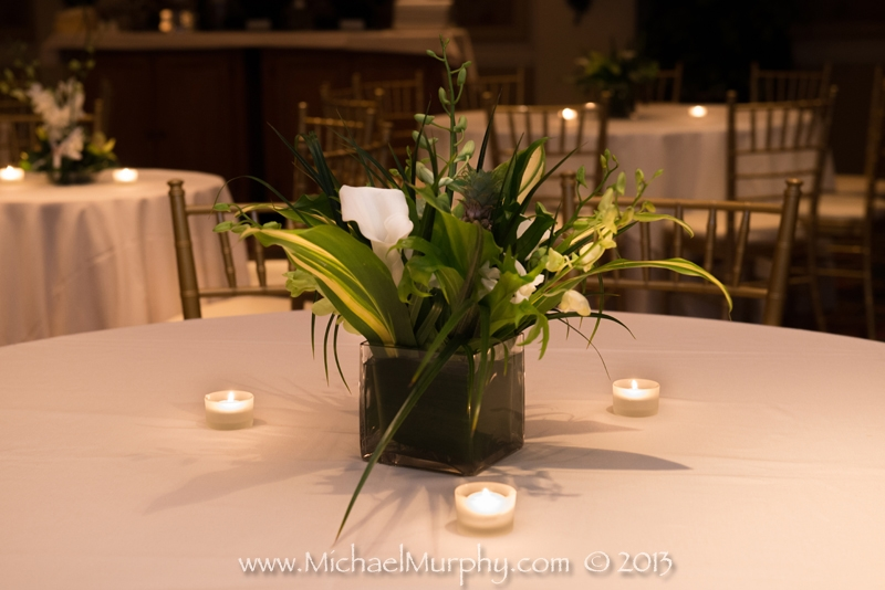 Candles and green grasses for a beachy wedding reception at the Riverside Hotel, Ft. Lauderdale.