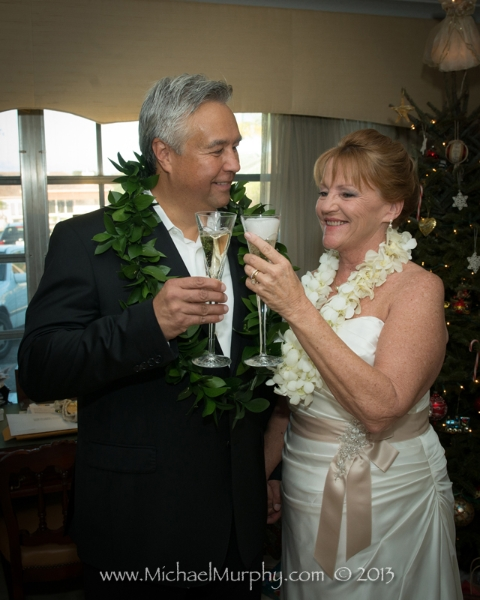 Bride and groom toast to their marriage at the Riverside Hotel, Ft. Lauderdale.