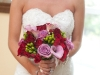 Bride with bouquet of pink and red at Lingrow Farm wedding, Pittsburgh.