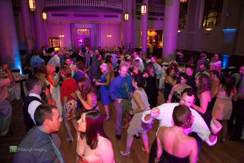 Guests dance at a Grand Hall at the Priory, Pittsburgh wedding reception.