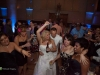 Bride and groom dance with wedding guests at a Grand Hall at the Priory, Pittsburgh wedding reception.