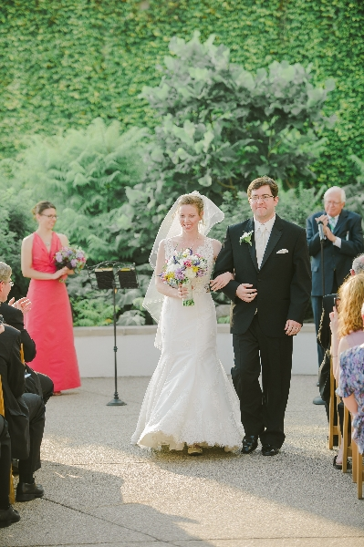 The bride and groom walk down the aisle after being married at the Phipps Conservatory, Pittsburgh.