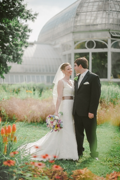The bride and groom pose at the Phipps Conservatory Gardens, Pittsburgh.