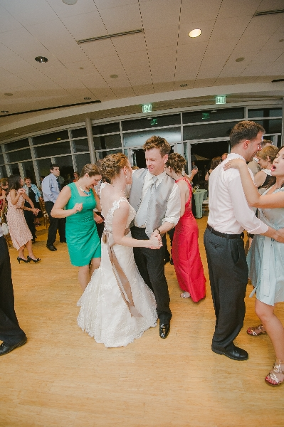 Bride dances with guests at her wedding reception in the Phipps Conservatory and Gardens, Pittsburgh.
