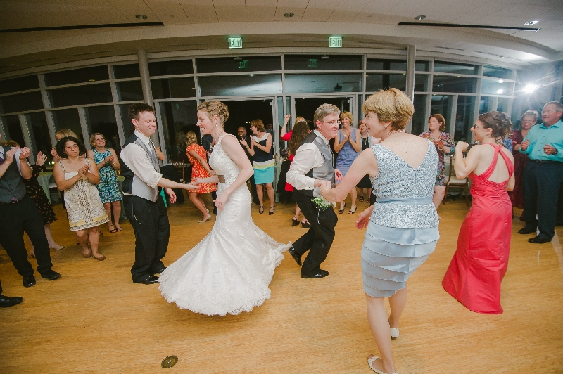 Bride and family on the dance floor at a Phipps Conservatory, Pittsburgh wedding.
