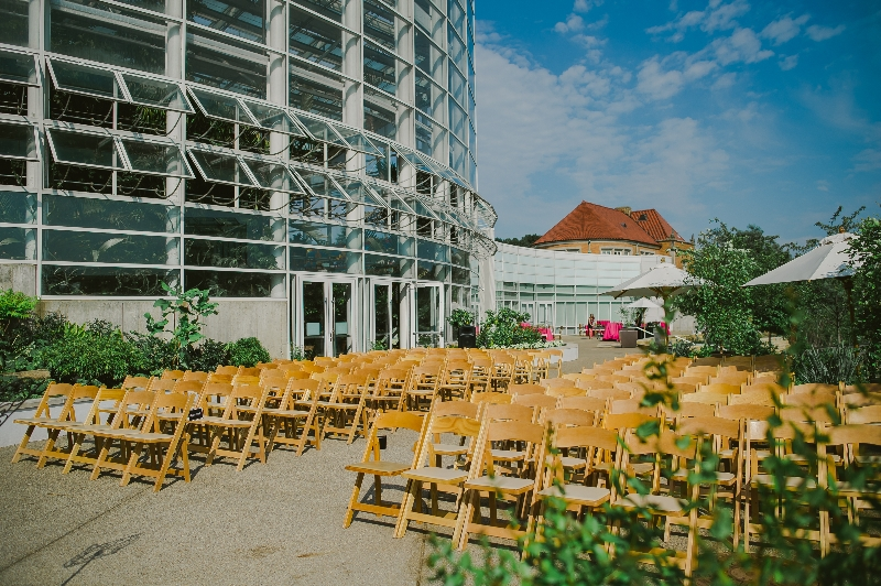 Wooden chairs set up for an outdoor wedding at the Phipps Conservatory, Pittsburgh.