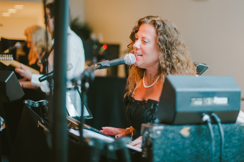 City Heat Band keyboard player and vocalist performing at a Phipps Conservatory, Pittsburgh wedding reception.