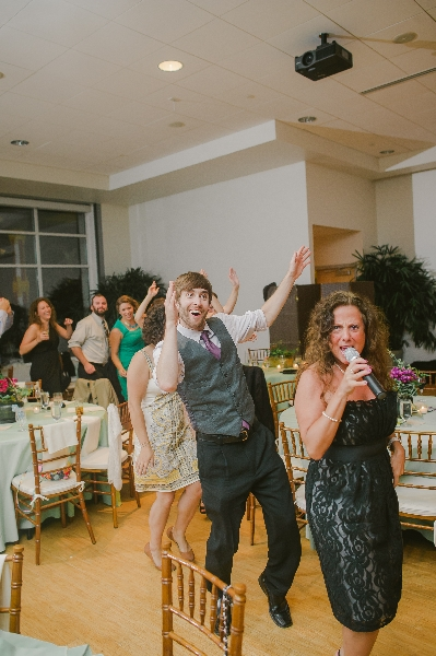 City Heat Band Vocalist leading a congo line at a Phipps Conservatory, Pittsburgh wedding reception.