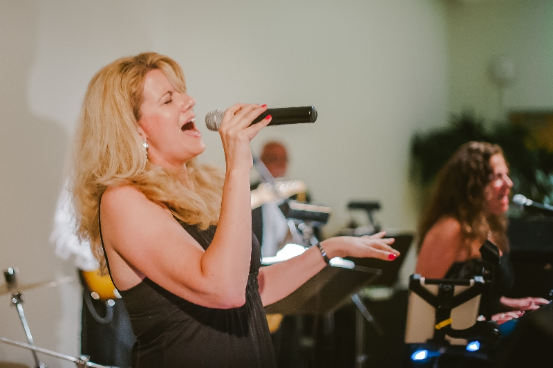City Heat Band Vocalist performing at a Phipps Conservatory, Pittsburgh wedding reception.