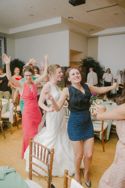 Guests dancing in a congo line at a Phipps Conservatory, Pittsburgh wedding reception.