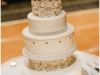 Six layer ivory wedding cake with crystals and rosettes at a Sheraton Station Square, Pittsburgh wedding.