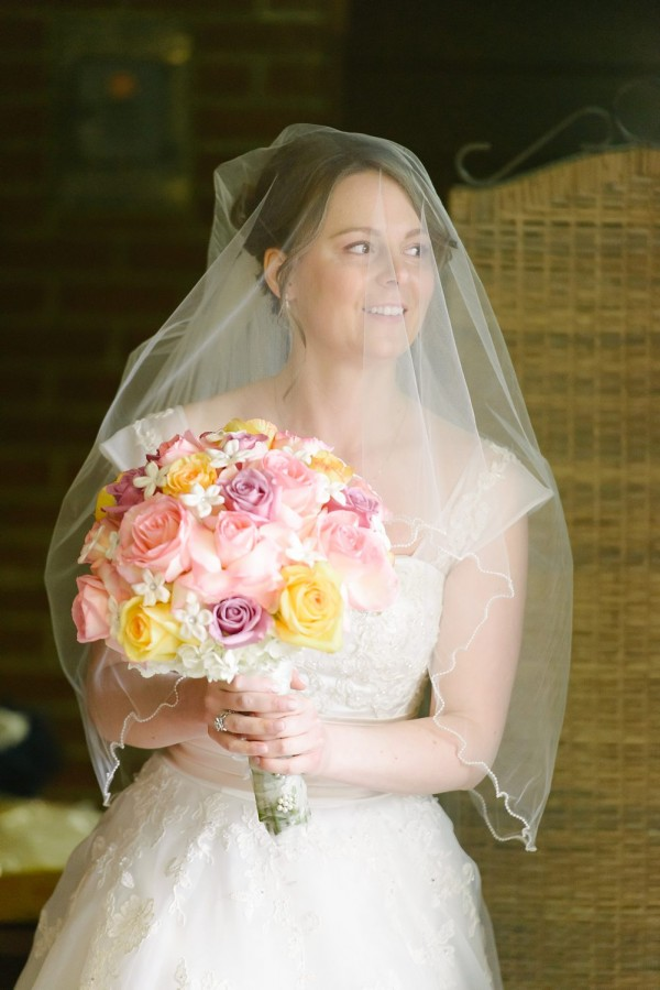 Circuit Center Pittsburgh Wedding - Bride in A-Line Gown Holding Flowers