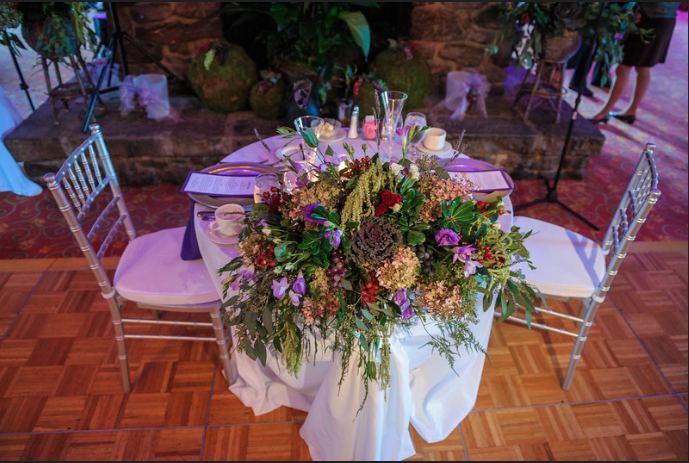 Peek n Peak Wedding Reception Sweetheart Table with Natural Floral Arrangement