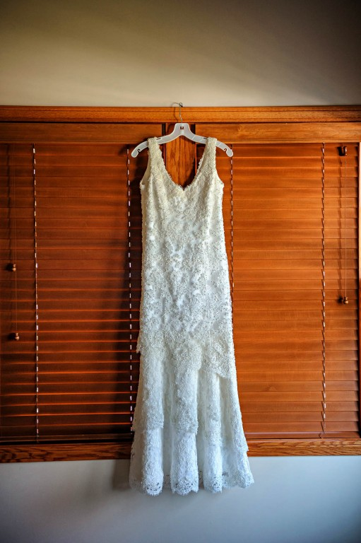 Peek n Peak Gorgeous Beaded and Detailed Wedding Dress Hung on Window