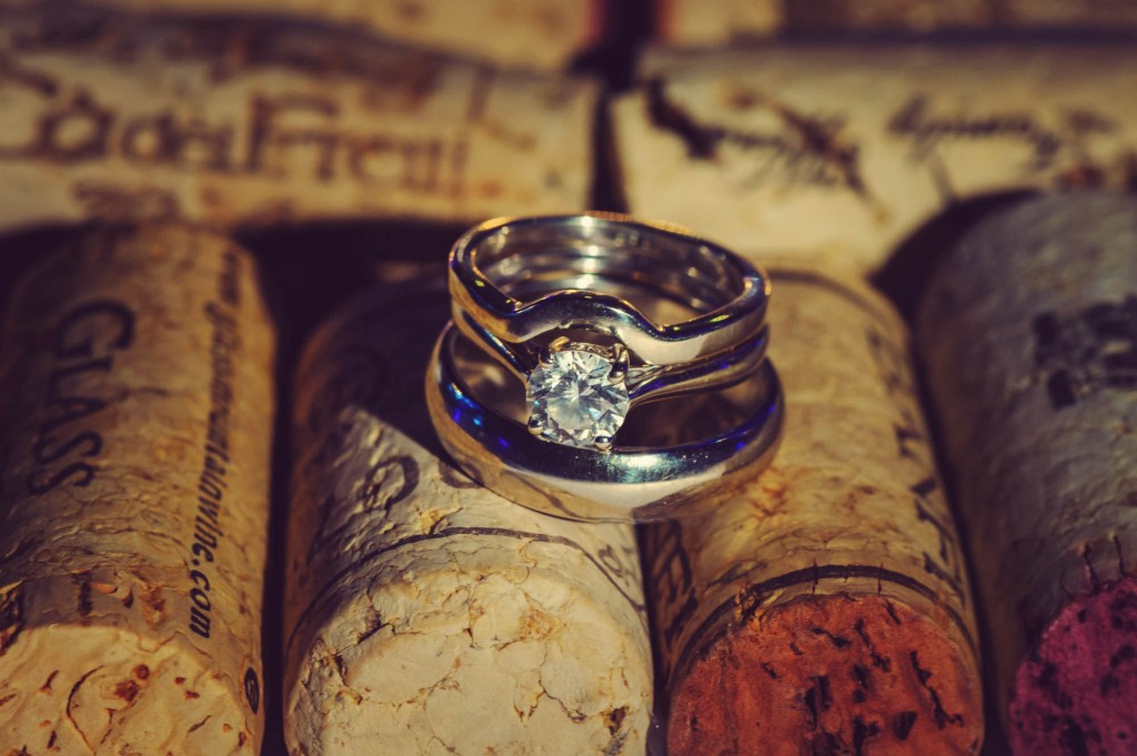 Peek n Peak Wedding Bands and Engagement Rings Resting on Wine Corks