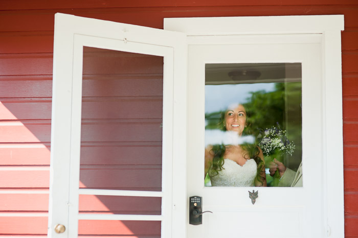 Foxley Farm Wedding Bride Coming Out of Farm House