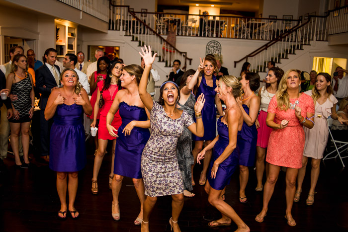Foxley Farm Wedding Reception Bridemaids and Guests Laughing During Garter Toss