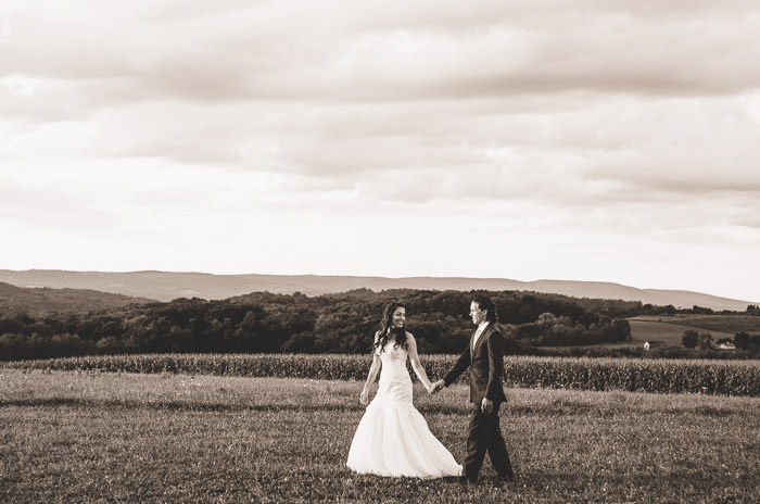 Foxley Farm Wedding Bride and Groom Walking Across Farm Field