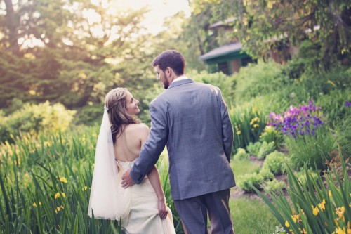 Green Gables Jennerstown Wedding Bride and Groom Strolling Through Gardens