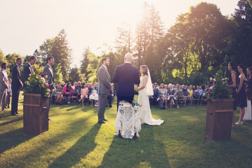 Green Gables Jennerstown Wedding Newlyweds Saying Vows in Outdoor Garden Ceremony