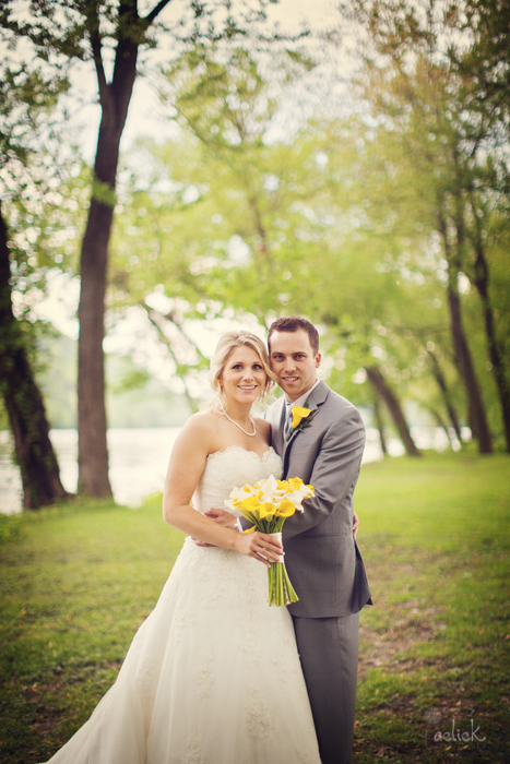 The Links Wedding Newlyweds Pose with Yellow Calla Lily Bouquet