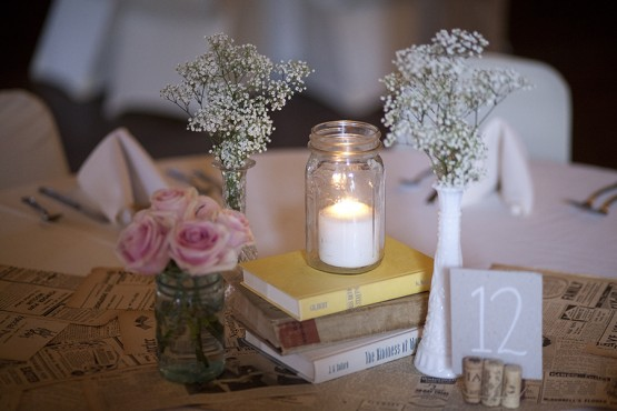 West Overton Barn Scottsdale Wedding Reception Table Centerpieces with Baby's Breath, Roses, Books, and Tealight Candles