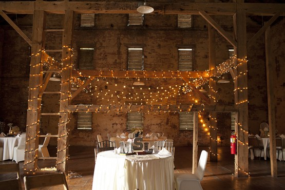 West Overton Barn Scottsdale Wedding Rustic Reception Space with Ceiling Beams Covered in Christmas Lights