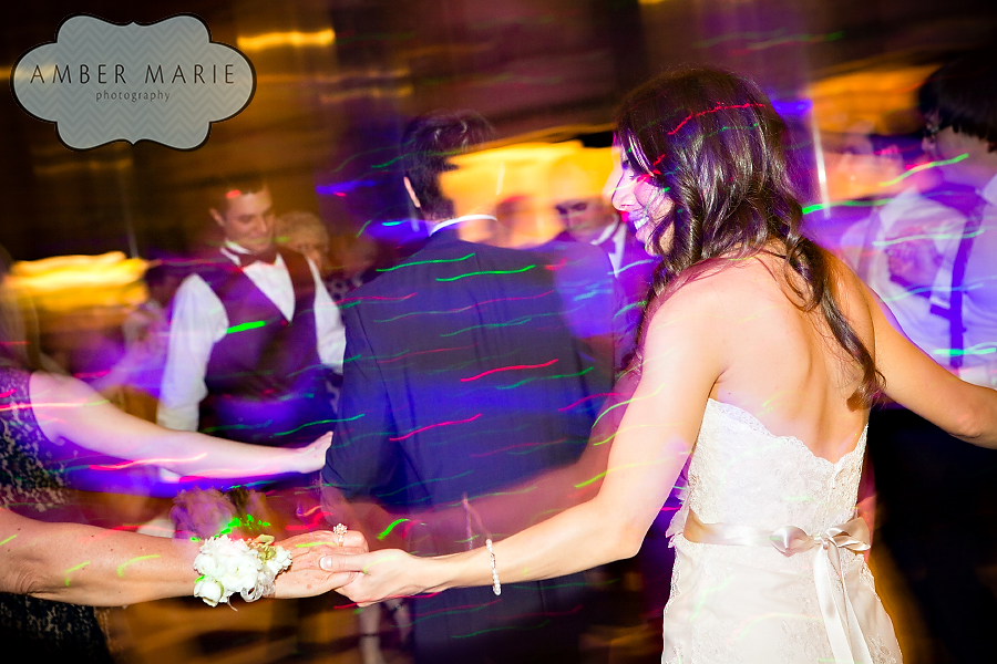 Carnegie Museums Pittsburgh Wedding Reception - Bride and Guests Spinning