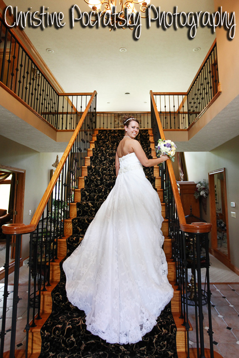 Hopwood Social Hall Wedding - Bride Shows Off Wedding Dress on Stairs