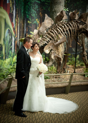 Carnegie Music Hall Pittsburgh Wedding: Bride and Groom Taking Photos in Museum