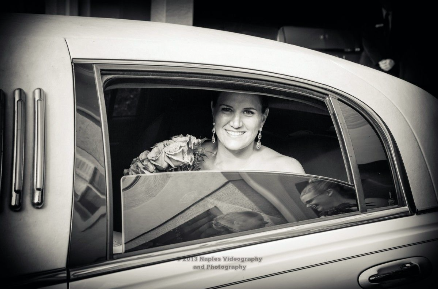 Golf Lodge at the Quarry Wedding: Bride Smiling in Limo