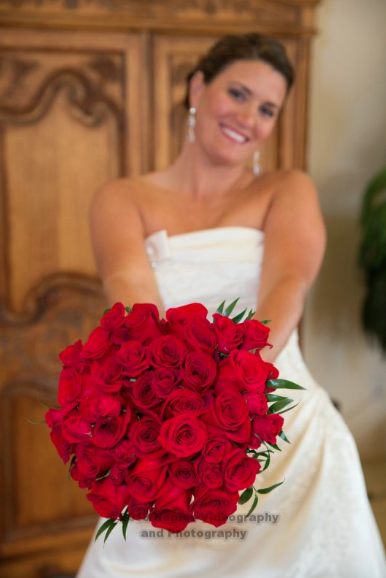 Golf Lodge at the Quarry Wedding: Bride and her Bouquet of Roses