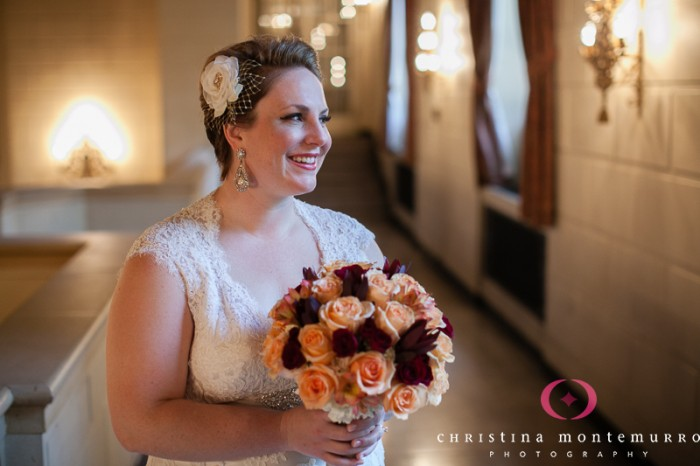 Heinz History Center Pittsburgh Wedding - Bride with Flower Hairpiece and Orange and Red Bouquet