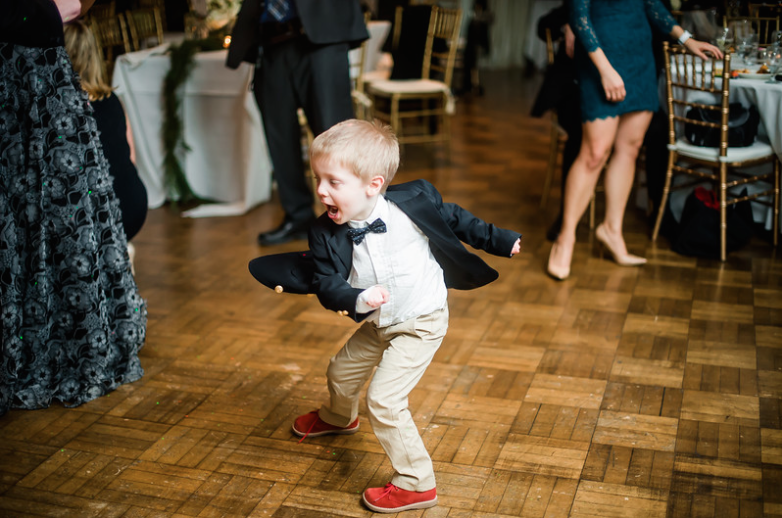 Longue Vue Club Wedding Reception: Child Spins on Dance Floor
