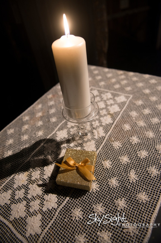 Green Gables Wedding Ceremony: White Candles and Gold Glitter Ring Box