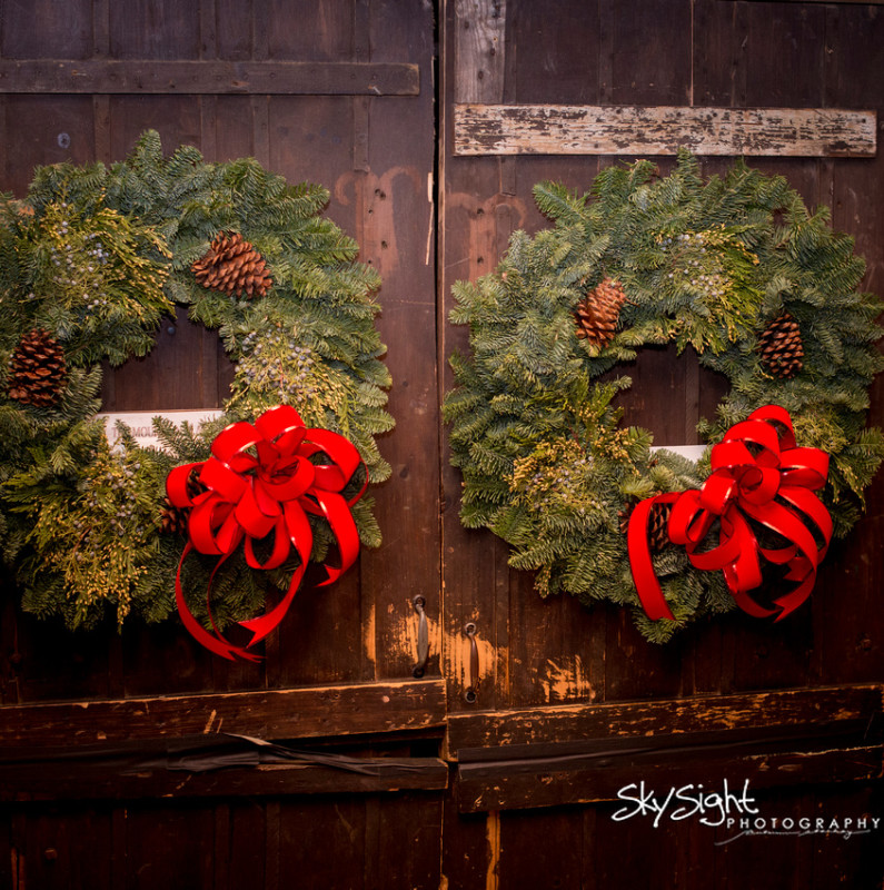 Green Gables Wedding Ceremony: Winter Wreaths With a Red Bow