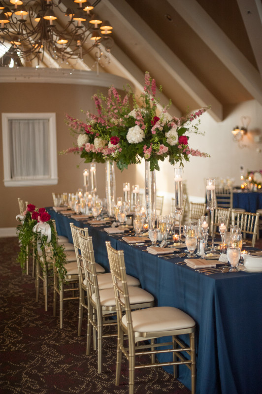The Club at Nevillewood Pittsburgh Wedding Reception: Couple's Main Table with Flower Backs