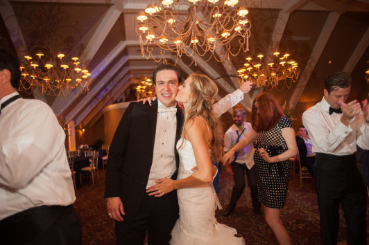 The Club at Nevillewood Pittsburgh Wedding Reception: Bride Kisses Groom on Cheek