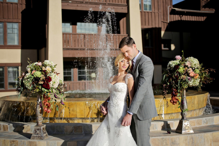 Hilton Garden Inn Southpointe Wedding: Newlyweds Pose Before Fountain
