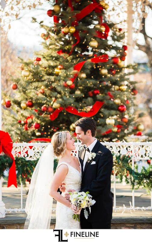 Rolling Rock Country Club Ligonier Wedding: Newlyweds Pose Before Christmas Tree