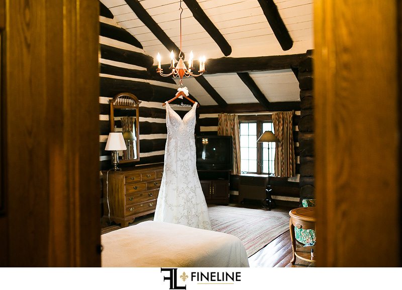 Rolling Rock Country Club Ligonier Wedding: V-Neck Wedding Dress Hanging From Chandelier