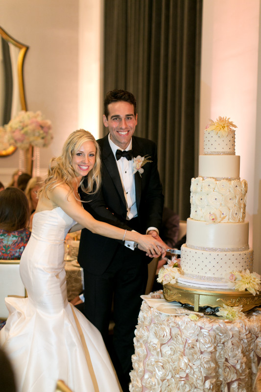 Hotel Monaco Pittsburgh Wedding Bride and Groom Cut Cake