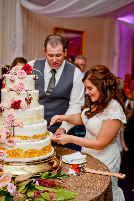 Parkersburg Country Club West Virginia Wedding Bride and Groom Cutting Cake