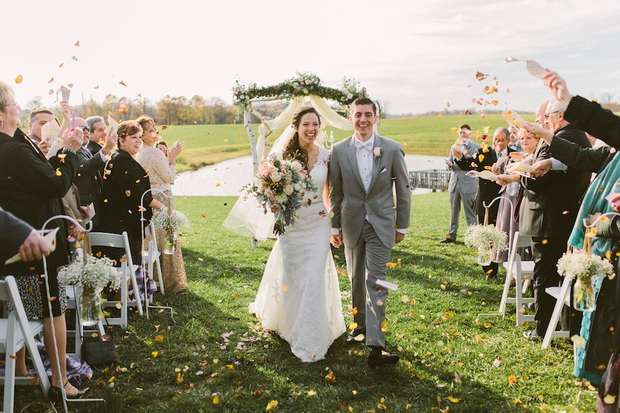 White Barn Pittsburgh Wedding Bride and Groom Showered with Roses