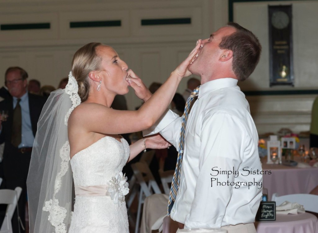 Memorial Hall Pittsburgh Wedding Bride and Groom Feed Each other Cake