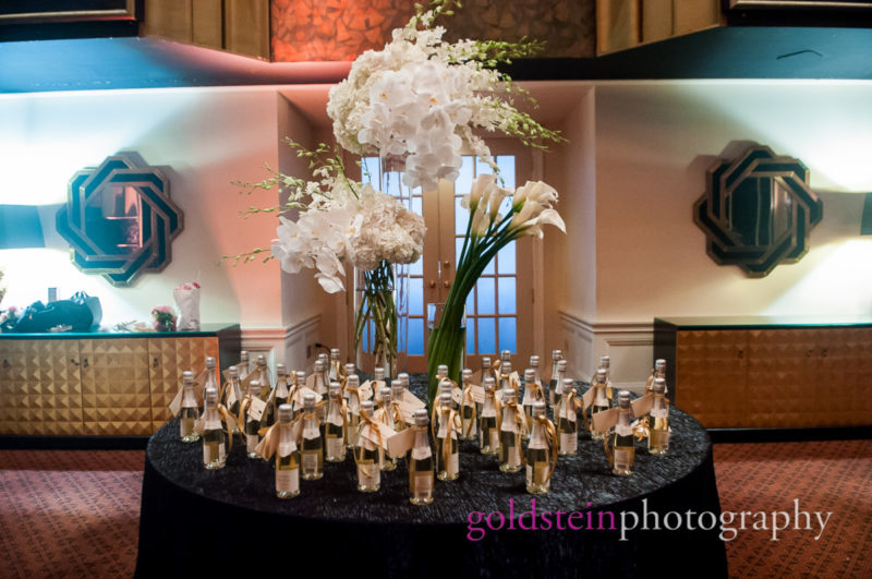 Wedding Orchids Lillies Centerpieces by Mocha Rose with Champagne Bottles with Tablecards